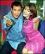 [ image: Johnny Vaughan with Kelly Brook earlier this year]