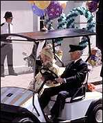 [ image: The Queen Mother used a buggy driven by her chauffeur to drive along the mall]