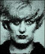 [ image: Marcus Harvey's portrait of Myra Hindley was composed of tiny hand prints]
