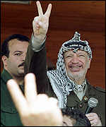 [ image: Mr Arafat placates the crowd]