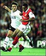 [ image: Thierry Henry holds off a challenge from Stefano Eranio]