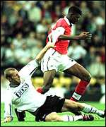 [ image: The elusive Kanu skips past a lunging tackle from Spencer Prior]
