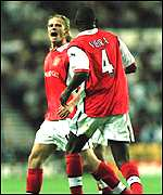 [ image: Emmanuel Petit and Patrick Vieira celebrate a stunning opening goal]