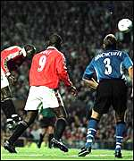 [ image: Dwight Yorke (left) directs the ball past Pavel Srnicek]
