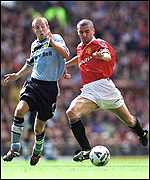 [ image: Roy Keane clashes with Leeds United's Lee Bowyer]