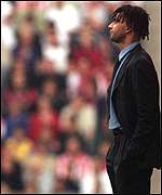 [ image: Gullit watches another disastrous diplay]