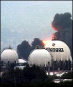 [ image: Smog alert: Liquid gas plant on fire]