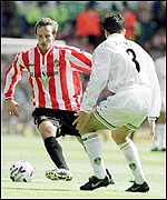 [ image: Nicky Summerbee takes on Leeds defender Ian harte]