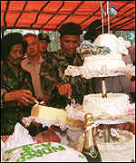 [ image: Pro-independence activitsts prepare for victory with an early cake]