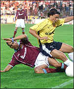 [ image: Paulo Di Canio slides in to tackle Sylvain Marnchal]