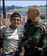 [ image: Soldiers arrest a man during the protest by Serbs]