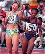 [ image: Ludmila Engqvist joins Gail Devers for the lap of honour]
