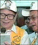 [ image: President Ramos (right) and President Jiang Zemin sing together in 1996]