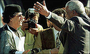 http://news.bbc.co.uk/olmedia/430000/images/_434698_gaddafi_mandela_300.jpg