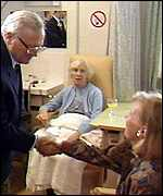 Secombe in a hospital ward