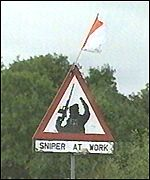 [ image: IRA signs in south Armagh show support for armed forces other than the RUC]