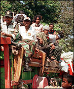 [ image: Thousands of East Timorese have fled or are being driven out by the military]