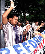 [ image: Anwar supporters marked the anniversary of his sacking]