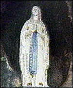[ image: The Our Lady of Lourdes statue....]