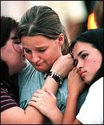 [ image: Distraught survivors outside the Wedgwood Baptist Church]