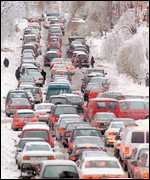 [ image: Traffic builds up as Montreal commuters struggle home]