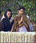 [ image: Sonia Ghandi and her daughter pay homage to assassinated Rajiv Gandhi]