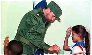 image: [ President Fidel Castro is saluted by pioneer scouts as he casts his vote in the Cuban elections ]