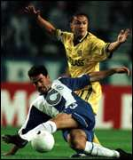 [ image: Dennis Wise finds it hard during the first half]