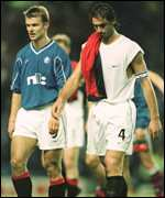 [ image: Amoruso and Numan disappointed after the final whistle]