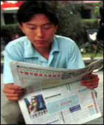 Beijing newspaper reader