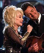 [ image: Country legend Dolly Parton performs with Vince Gill]