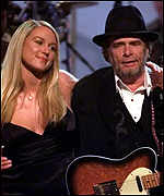 [ image: Pop star Jewel on stage with 'old-timer' Merle Haggard]