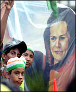 [ image: Supporters with a cutout of Sonia Gandhi]