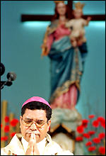 [ image: Bishop Belo in Portugal, praying for peace]