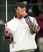 [ image: Tiger Woods wipes his brow as the European pair fight back]