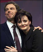 [ image: Tony Blair takes the applause and hugs wife Cherie]
