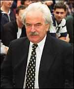[ image: The former BBC sports presenter Des Lynam attended the service]