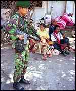 [ image: A heavy Indonesian military presence has been a feature of East Timorese life for over two decades]