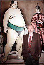 [ image: Buffet poses next to his painting Sumo and Kaduki in 1988]
