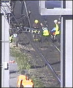 [ image: Rescuers worked to free trapped passengers]