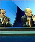 [ image: William Hague joins in applauding the shadow home secretary]