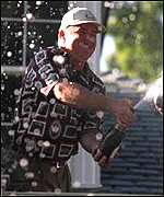 [ image: Mark O'Meara cracks open the bubbly after the US victory]