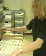 [ image: Counterfeit videos are checked by a trading standards officer]