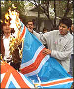 [ image: The general's supporters burn the Union Jack in Chile]