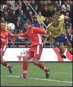 [ image: Henrik Larsson launches into a Swedish attack]