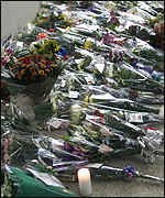 [ image: Bouquets at the site cover a 30ft area]