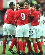 [ image: Goalscorer Jamie Redknapp is surrounded by England players]