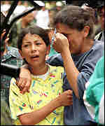 [ image: Maria Gil, right, and daughter mourn over the body of her youngest son.]