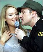 [ image: Bono and US singer Jewel at the Giants Stadium, New Jersey]
