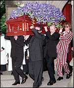 [ image: The other members of INXS carry Hutchence's coffin at his funeral]
